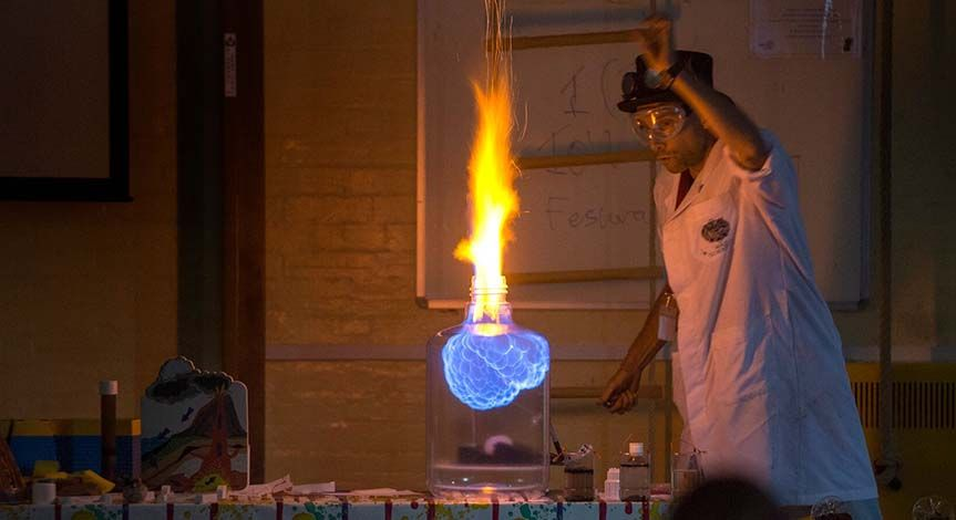 A Mad Scientist making fire in a glass jar